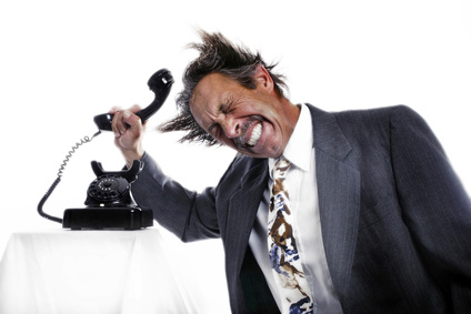 Businessman knocking his head with a phone receiver.
